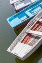 Colorful wooden rowboats anchor at pier. Royalty Free Stock Photo