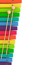 Colorful wooden xylophone with mallets on a white background Stock Image