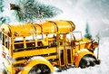 Colorful yellow bus carrying a Christmas tree Royalty Free Stock Photo