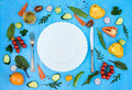 Colorfull fresh salad ingredients around empty white plate with Royalty Free Stock Photo