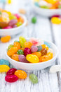 Colorfull jelly beans close up shot on bright wooden background Stock Photos
