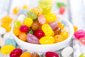 Colorfull jelly beans close up shot on bright wooden background Royalty Free Stock Photo