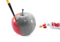 Coloring a black and white apple clack being colored with paintbrush Royalty Free Stock Photography