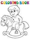 Coloring book boy on rocking horse Royalty Free Stock Photo