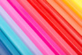 Coloring crayons arranged in rainbow line abstract close up Royalty Free Stock Images