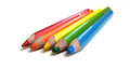 Coloring pencils five wooden of red orange yellow green and blue Royalty Free Stock Image