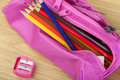 Coloring pencils in a pink pencil case with pink sharpener Royalty Free Stock Photo