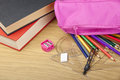Coloring pencils spilling out of a pink pencil case Royalty Free Stock Photo