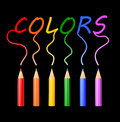 Colors colored pencils writing word on black background Royalty Free Stock Images