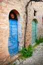 Colors of italy umbria two old doors in a typical stone village Stock Photo