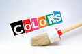 Colors paintbrush below the lettering Royalty Free Stock Photo