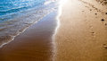 Colors of summer sand sunshine and blue water Royalty Free Stock Photography