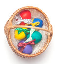Colorul easter eggs on braiding basket Royalty Free Stock Photo