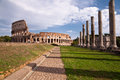 Colosseo and venus temple columns and path view from roman forum italy Royalty Free Stock Photos