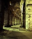 Colosseum arches rome italy underneath the of the at night lazio europe Stock Photos
