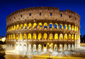 The colosseum at night rome italy in Royalty Free Stock Photos