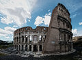 Colosseum rome italy mar dramatic blue sky clouds architecture gladiator arena roman amphitheatre Stock Photo
