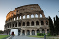 Colosseum in romeat sunrise italy Stock Photos