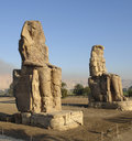 Colossi memnon two huge ancient statues near luxor egypt africa evening time Royalty Free Stock Images