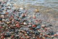 Colour beach pebbles on the flood by sea Royalty Free Stock Image