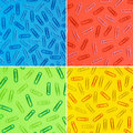 Colour paper clips on colourful paper Royalty Free Stock Photography