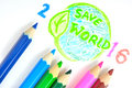 Colour pencil writing the save world Royalty Free Stock Photos