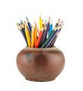 Colour pencils in clay jar isolated on white background Royalty Free Stock Image