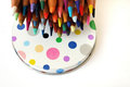 Colour pencils on polka dots fun concept a photograph showing a bunch of colouful color showing only the sharp tips placed a white Stock Images