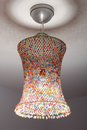 Coloured lampshade a is out of netting and beads Royalty Free Stock Image