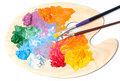 Coloured oil paint and brushes on the palette Royalty Free Stock Photo