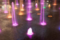 Coloured orange pink and green  fountain Royalty Free Stock Photo