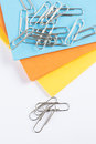 Coloured paper with paperclips on top of the Stock Photo