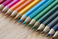 Coloured pencils against a wooden background Royalty Free Stock Photo