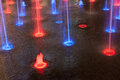 Coloured red blu and violet fountain Royalty Free Stock Images