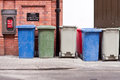 Coloured wheelie bins a row of different Stock Image