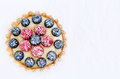 Colourful appetising tart top down perspective of a brightly coloured mix berry dessert Royalty Free Stock Photos