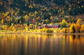 Colourful autumn landscape with country houses scenery norwegian near a lake Stock Images