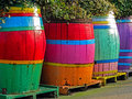 Colourful barrels old barres as a plants pots Royalty Free Stock Photo