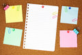Colourful blank note paper on brown corkboard notes pinned into with clips Royalty Free Stock Image