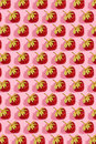 Colourful bright pattern with ripe strawberry. Top view. Pink background Royalty Free Stock Photo