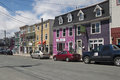 Colourful businesses along street in the quidi vidi district of may saint johns newfoundland canada Royalty Free Stock Images