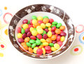 Colourful candies some in a bowl Royalty Free Stock Photography