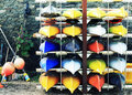 Colourful canoes in a row Stock Photo