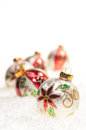 Colourful Christmas  baubles on snow Stock Photography