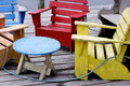 Colourful dock chairs peggy s cove an salty collection of brightly coloured wooden on a at nova scotia Stock Photography