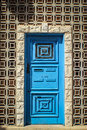 Colourful door surrounded by geometric stones Royalty Free Stock Photo