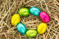 Colourful easter eggs circle straw Royalty Free Stock Photo