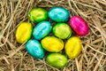 Colourful easter eggs grouped together straw Stock Images