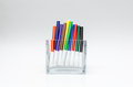 Colourful felt pens bright vivid in the row in see thru container Stock Images