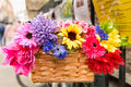 Colourful flowers in bike basket with Stock Photo